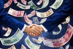 Chino Yuan Money Handshake Business Imagen de archivo