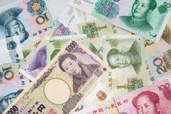 Chino Yuan y yenes japoneses Fotografía de archivo libre de regalías
