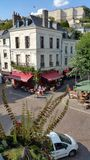Chinon loire valley France. Chinon central square with cafe terrace and fortress in background Royalty Free Stock Photography