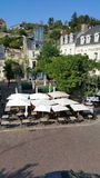 Chinon loire valley France. Chinon central square with cafe terrace and fortress in background Royalty Free Stock Images