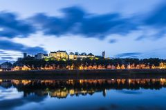 Chinon town France during the blue hour. Chinon town located in the heart of the Val de Loire, France during the blue hour . Well known for its wines, castle and stock images
