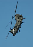 Chinook. Military chinook transport helicopter demonstrating a near vertical dive royalty free stock photo