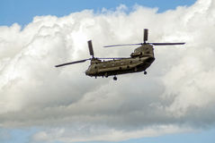 Chinook. A chinook in the air, against a cloudy sky background Stock Photography