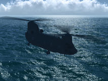 Chinook CH-47 flying over ocean Stock Images