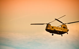 Chinook flying into the sunset. Chinook flies into the sunset Stock Photo
