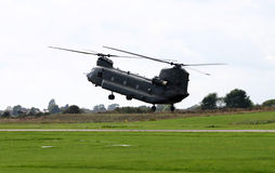 Chinook helicopter. Hovering over air field Stock Images