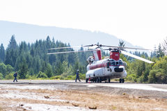 Chinook helicopter and fire crew Royalty Free Stock Photography