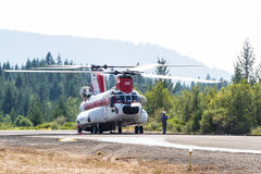 Chinook helicopter and fire crew Royalty Free Stock Images