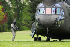 Chinook Helicopter Preparation To Fly. Some natural and manmade disasters require rescue services. This is a Chinook helicopter being used in a mock disaster Royalty Free Stock Images