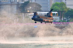 Chinook hovering over river during NDP 2011 Royalty Free Stock Photos