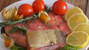 Chinook salmon LAT. Oncorhynchus tshawytscha smoked. With fresh Greens and vegetables stock video footage