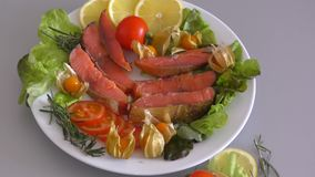 Chinook salmon LAT. Oncorhynchus tshawytscha smoked. With fresh Greens and vegetables stock video