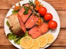 Chinook salmon LAT. Oncorhynchus tshawytscha smoked. With fresh Greens and vegetables Royalty Free Stock Images