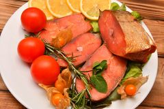 Chinook salmon LAT. Oncorhynchus tshawytscha smoked. With fresh Greens and vegetables Stock Photos