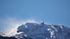 Chinook winds sweeping snow off mountain top Royalty Free Stock Photography