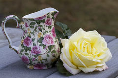 Chintz and Roses Still Life. This is a yellow and pink climbing peace rose and a bone china pink rose chintz pitcher still life stock photography