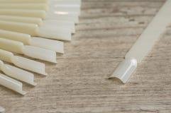 Chiodi arificial bianchi Immagini Stock