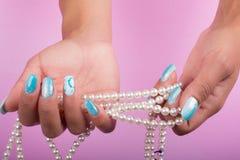 Chiodi e perle dipinti Fotografia Stock Libera da Diritti