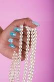 Chiodi e perle dipinti Immagine Stock
