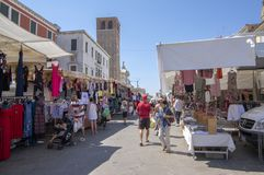 Chioggia / ITALY - june 21, 2018: Traditional markets on the main street of the Italian city are held every Thursday. Happy people are spending their money and royalty free stock photography