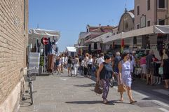 Chioggia / ITALY - june 21, 2018: Traditional markets on the main street of the Italian city are held every Thursday. Happy people are spending their money and royalty free stock photo
