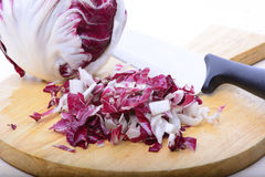 Chioggia salade. Into pieces on wood cutting board Stock Photography