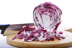 Chioggia salade. Into pieces on wood cutting board Stock Image