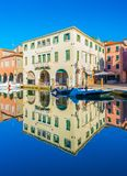 Chioggia, Italy:  Old buildings in the traditional Venetian architecture style reflected in water Royalty Free Stock Images