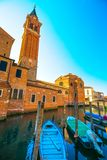 Chioggia town in venetian lagoon, boats, water canal and church. Veneto, Italy, Europe Stock Photo
