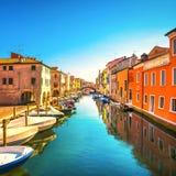Chioggia town in venetian lagoon, water canal and church. Veneto Stock Image