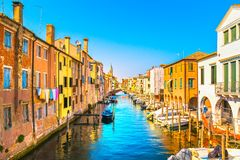 Chioggia town in venetian lagoon, water canal and church. Veneto. Italy, Europe Stock Photo
