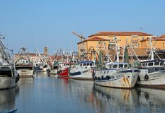Chioggia, VE, Italy - February 11, 2018: wide canal with fishing Stock Photo