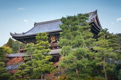 Chion-in Sanmon Buddhist Temple surrounded by vegetation in Kyoto, Japan. View of Chion-in Sanmon Buddhist Temple with large pine trees in the foreground on a royalty free stock image