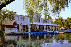 Chios Casino, restaurant and terrace. Near the lake in central park Cluj-Napoca, Romania. People rent swan pedal boats and wooden boats Royalty Free Stock Photos