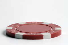 Chip. Hi quality image of a red poker chip with a white background, big size taken with macro lens, extreme resolution royalty free stock image