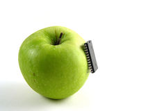 Chip-attack on green apple! (Full). Full view of green apple with chip attached as a symbol for bio-genetical manipulations Royalty Free Stock Photos