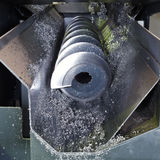 Chip auger and metal turnings Stock Images