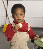 Chip or cookie. Baby with potato chip and cookie stock photos
