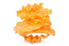Chip costolati della patata su bianco Fotografia Stock Libera da Diritti