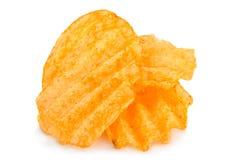 Chip costolati della patata su bianco Immagine Stock