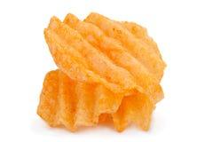 Chip costolati della patata su bianco Fotografie Stock