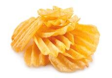 Chip costolati della patata su bianco Fotografia Stock