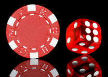 Chip and dice. Red poker chip and dice royalty free stock image