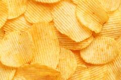 Chip dorati ondulati del fondo con struttura Fotografie Stock Libere da Diritti