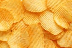Chip dorati ondulati del fondo con struttura Fotografia Stock Libera da Diritti
