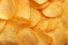 Chip dorati ondulati del fondo con struttura Fotografie Stock