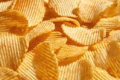 Chip dorati ondulati del fondo con struttura Immagine Stock Libera da Diritti