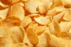 Chip dorati ondulati del fondo con struttura Fotografia Stock