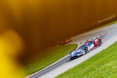 IMSA:  May 04 Acura Sports Car Challenge. The Chip Ganassi Racing Ford GT races through the turns at the Acura Sports Car Challenge at Mid Ohio Sports Car Course Royalty Free Stock Photos