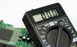 Chip and multimeter Royalty Free Stock Images